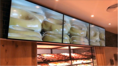 Krispy Kreme UK push digital in-store experiences with embed signage